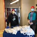 Coordinator, Healthier Middlesex Robert LaForgia and Unity Square Staff Member Hector Perez assist in the distribution of Coronavirus Care Kits provided by St. Peter's Hospital in New Brunswick.